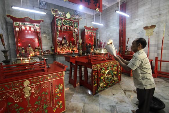 A Chinese man offers prayers at a temple during Chinese New Year celebrations in Kolkata.