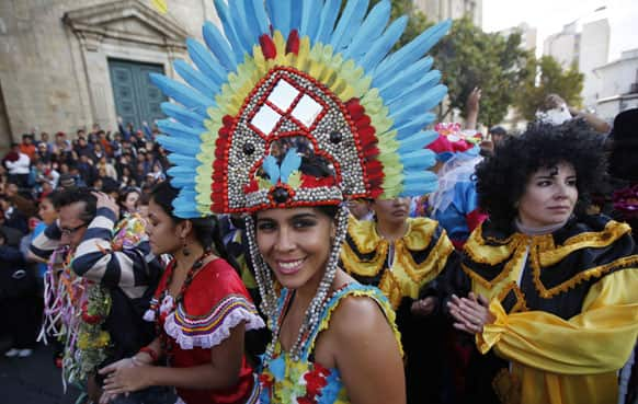 A woman smiles to the camera as she joins Carnival celebrations in La Paz, Bolivia.
