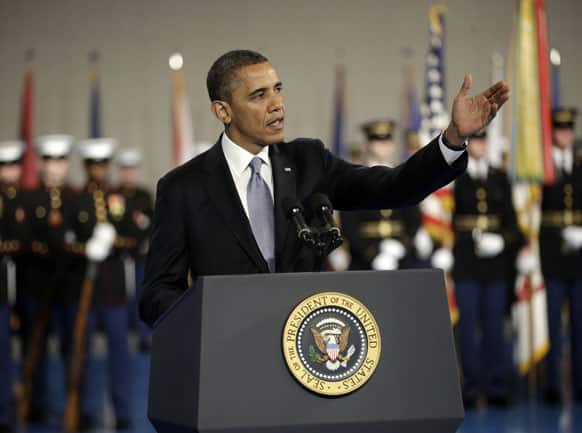 President Barack Obama gestures speaks during an Armed Forces Farewell Ceremony to honor outgoing Defense Secretary Leon Panetta.