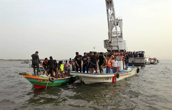 Bangladesh`s navy members search for victims of a ferry accident in the River Meghna at Munshiganj, south of Dhaka. A passenger ferry capsized Friday after colliding with another ship on the river in central Bangladesh, dumping as many as 100 people into the water.