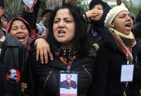 Tunisian women gather in front of the house of slain opposition leader Chokri Belaid`s father prior to his funeral in Tunis.
