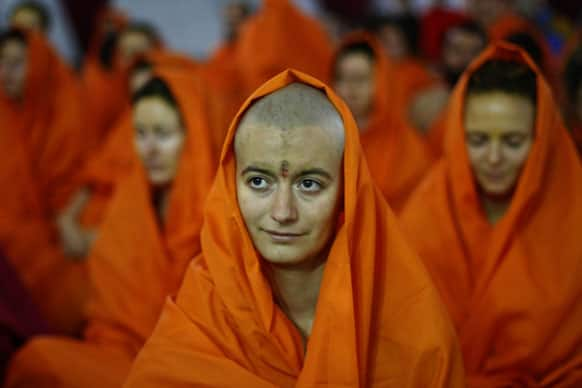 Female foreign devotees participate in a consecration ceremony for becoming Hindu holy women at Pilot Baba camp at Sangam, the confluence of rivers Ganges, Yamuna and mythical Saraswati, as part of the Maha Kumbh festival in Allahabad,