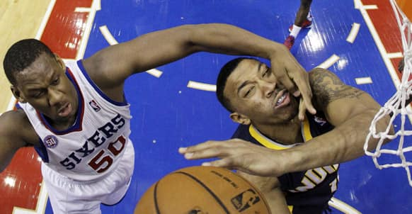 Indiana Pacers` Orlando Johnson, right, is fouled by Philadelphia 76ers` Lavoy Allen while taking a shot during the second half of an NBA basketball game, in Philadelphia.