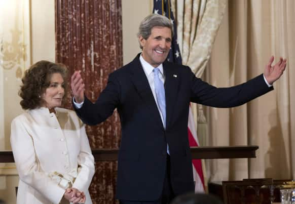 Secretary of State John Kerry, with his wife Teresa Heinz Kerry, reacts to the speech of Vice President Joe Biden during his ceremonial swearing-in as the 68th secretary of state, at the State Department in Washington.