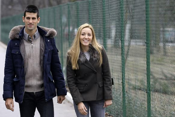 Serbia`s tennis player Novak Djokovic and his girlfriend Jelena Ristic arrive for a visit to a school for mentally challenged children in Belgrade, Serbia.