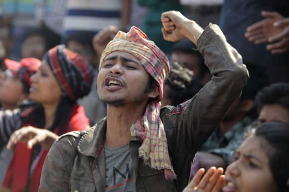 A man shouts slogans as government activists and other Bangladeshi people gather for a protest demanding death penalty for Jamaat-e-Islami leader Abdul Quader Mollah in Dhaka, Bangladesh.
