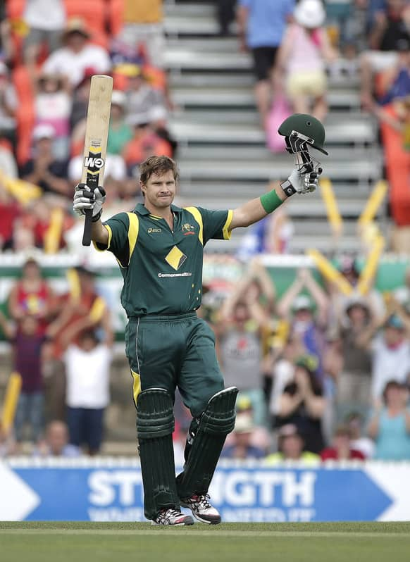 Australia`s Shane Watson celebrates hitting a century during their One Day International Cricket match against West Indies in Canberra.