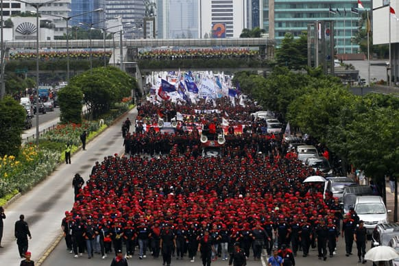 Indonesian worker march during a protest rally in Jakarta. Thousands of Indonesian workers staged the rally demanding the government for implementation of minimum wage.