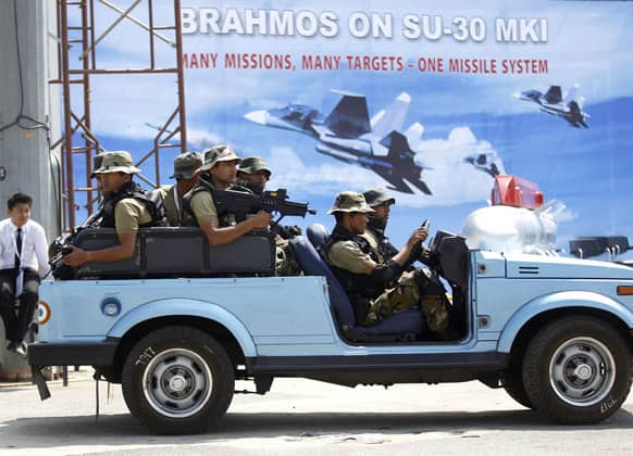 Indian military commandoes patrol during rehearsals on the eve of the Aero India 2013 at Yelahanka air base in Bangalore.