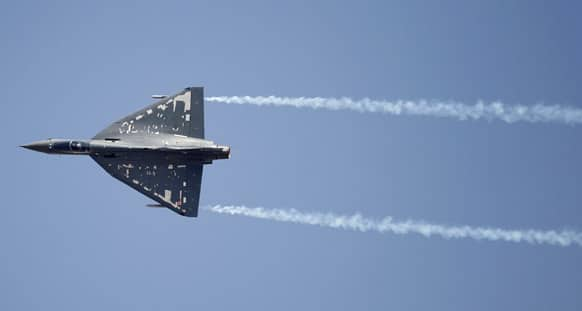 Indian Air Force single engine, tailless fighter aircraft Tejas performs during rehearsals on the eve of the Aero India 2013 at Yelahanka air base in Bangalore.