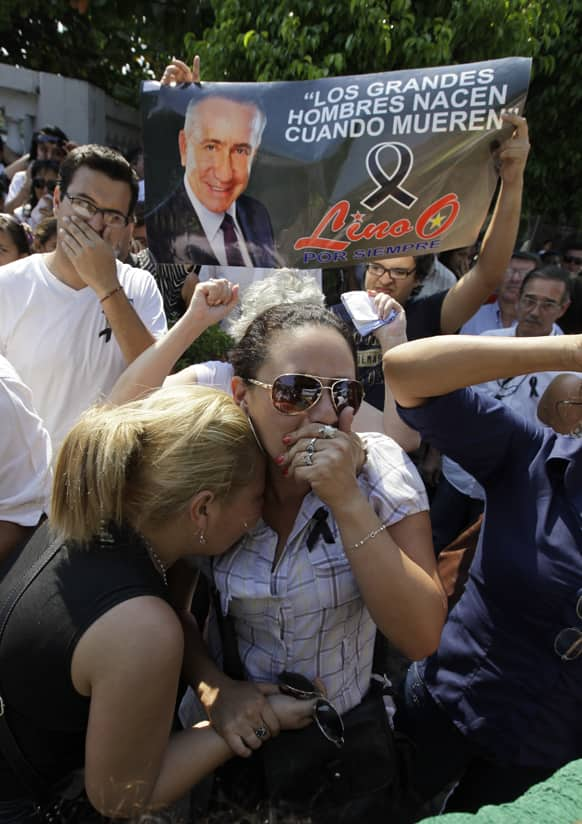 Supporters of the late Paraguayan presidential candidate Lino Oviedo react as his coffin is taken to another location for his wake in Asuncion, Paraguay.