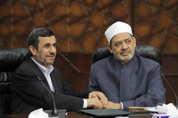 Iran`s President Mahmoud Ahmadinejad, left, shakes hands with Grand Sheik Ahmed al-Tayeb, the head of Al-Azhar, the Sunni Muslim world`s premier Islamic institution during their meeting at Al Azhar headquarters in Cairo.