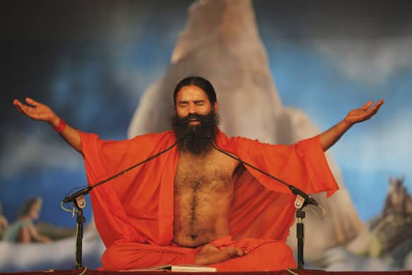 Baba Ramdev performs yoga at Sangam, the confluence of rivers Ganges, Yamuna and mythical Saraswati during the Maha Kumbh festival in Allahabad.