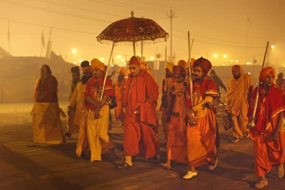 Leader Swami Avdheshanand Giri arrives to initiate Hindu holy men of the Juna Akhara during rituals that is believed to rid them of all ties in this life and dedicate themselves to serving God as a `Naga` or naked holy men, at Sangam.