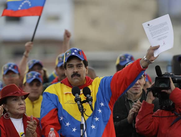 Venezuela`s Vice President Nicolas Maduro holds up a letter that he said it was sent by Venezuela`s President Hugo Chavez to his supporters during a demonstration commemorating the anniversary of a failed coup attempt led by Chavez in 1992, in Caracas, Venezuela.