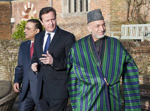 Britain`s Prime Minister David Cameron, centre, hosts a trilateral meeting with President Hamid Karzai of Afghanistan, right, and President Asif Ali Zardari of Pakistan, left, at his official country residence at Chequers, near Wendover, England.