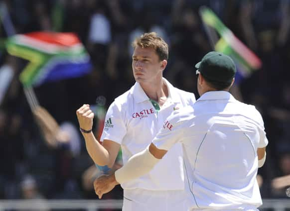 South Africa`s Dale Steyn, left, celebrate with Dean Elgar after taking the wicket of Misbah-ul-Haq of Pakistan for 64 runs during their cricket test match in Johannesburg.