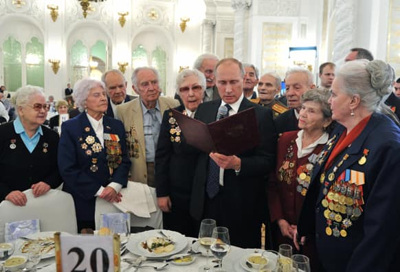 Russian President Vladimir Putin, center, meets with World War II veterans at a reception marking the 70th anniversary of the Battle of Stalingrad, in the Kremlin in Moscow, Russia.