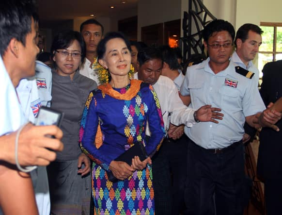 Myanmar opposition leader Aung San Suu Kyi, center, arrives for the second day of the Irrawaddy Literary Festival in Yangon, Myanmar.