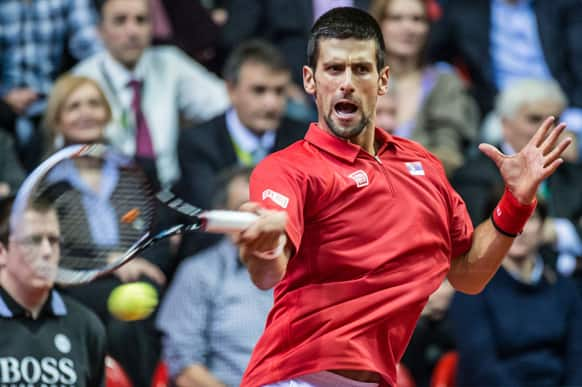 Serbia`s Novak Djokovic returns the ball during the Davis Cup World Group first round match against Belgium`s Olivier Rochus at the Spriroudome in Charleroi, Belgium.