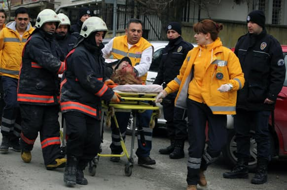 Medics carry an injured woman on a stretcher to an ambulance after a suspected suicide bomber detonated an explosive device at the entrance of the U.S. Embassy in the Turkish capital, Ankara.
