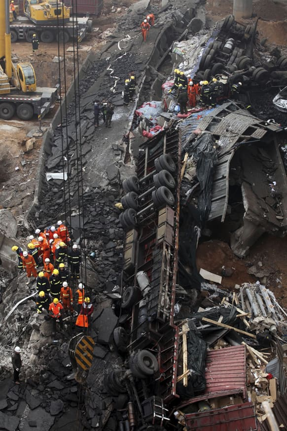 Rescuers work at the accident site where an expressway bridge partially collapsed due to a truck explosion in Mianchi County, Sanmenxia, central China`s Henan Province.