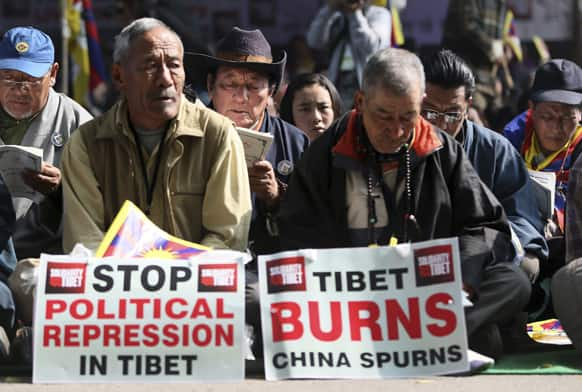 Exiled Tibetans pray in a rally during Tibetan People`s Solidarity Campaign in New Delhi. The four-day campaign that began Wednesday is held to express solidarity with Tibetans inside Tibet and to raise awareness and seek international support for Tibet.