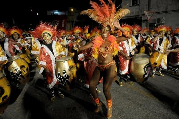 Revelers perform during Las Llamadas or parade of The Calls in Montevideo, Uruguay.