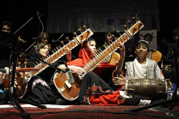 Afghan girl- students of Afghanistan National Institute of Music play sitars during a concert at the French cultural center in Kabul.