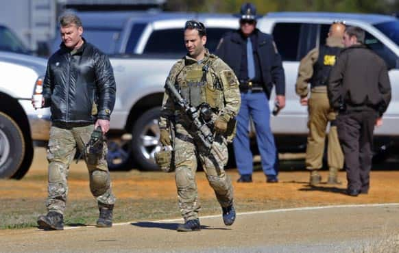 Law officers at the Dale County hostage scene in Midland City, Ala.