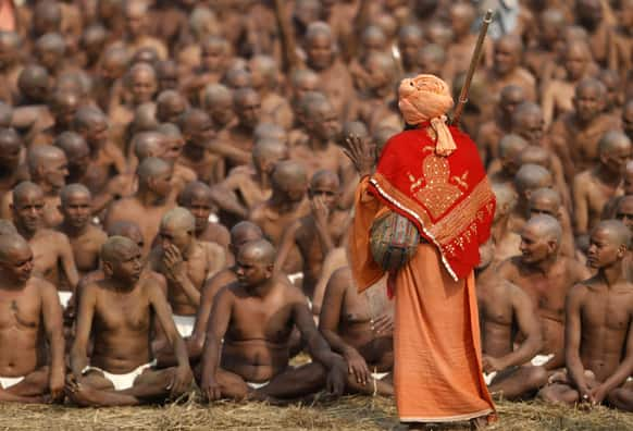 Hindu holy men of the Juna Akhara sect participate in rituals that are believed to rid them of all ties in this life and dedicate themselves to serving God as a `Naga` or naked holy men, at Sangam, the confluence of the Ganges and Yamuna River during the Maha Kumbh festival in Allahabad.