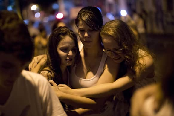 People react during a march near the Kiss nightclub honoring the victims of early Sunday`s fatal fire inside the club in Santa Maria, Brazil.