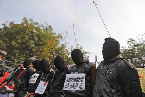 Six men enact a mock hanging during a protest demanding the death penalty for six men accused of the fatal gang rape of a young woman in New Delhi last month in New Delhi.