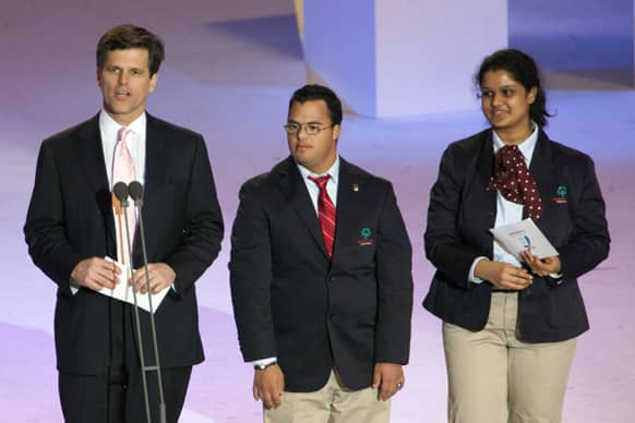 Timothy P. Shriver Ph.D. Chairman and CEO of the Special Olympics, left, gives his opening address with International Global Messengers Ariel Ary of Costa Rica and Neha Naik of India during the 2013 Special Olympics World Winter Games opening ceremony in PyeongChang, South Korea.