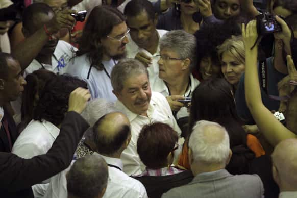 Brazil`s former President Luiz Inacio Lula da Silva, center, surrounded by journalists, arrives to attend the International Congress for World Balance in Havana, Cuba.