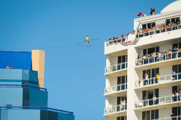 Aerialist Nick Wallenda walks the high wire 200 feet over U.S. 41 in Sarasota, Fla., without a safety harness.