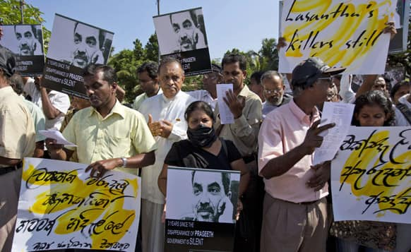 Journalists, rights activists and opposition lawmakers shout slogans and display placards during a demonstration alleging the government of suppression of media in Colombo.