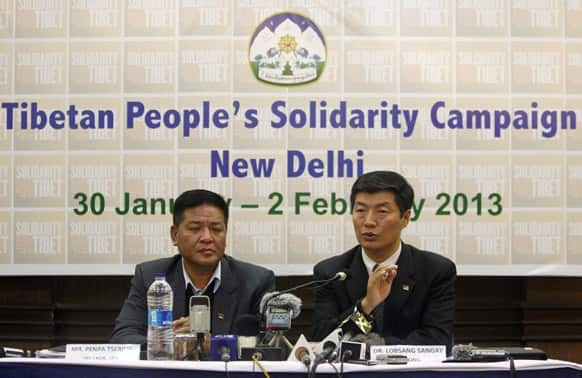 Prime Minister of the Tibetan government-in-exile Lobsang Sangay, right, speaks as Speaker Penpa Tsering listens during a press conference in New Delhi.