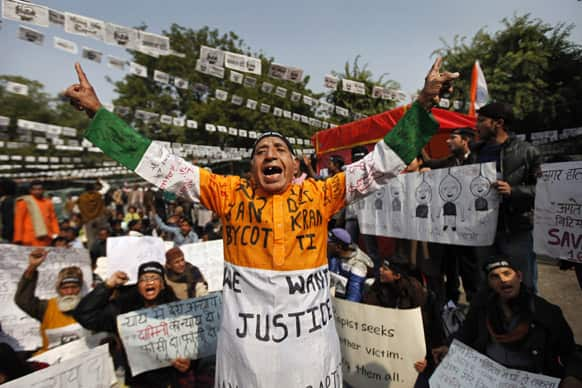 An elderly protester, wearing an outfit with the colors of the Indian national flag, shouts slogans during a protest demanding the death penalty for six men accused of a fatal gang rape of a young woman in New Delhi last month.