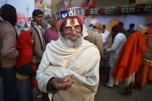 A Hindu holy man smiles as he walks back after receiving charitable food during the Maha Kumbh festival in Allahabad.