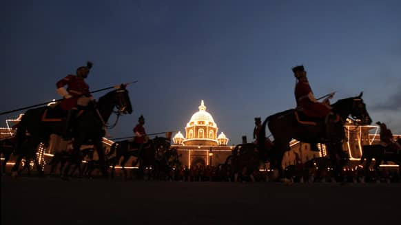 Horse mounted Indian presidential body guards return after full dress rehearsals of the Beating Retreat ceremony at Raisina hill which houses India`s most important ministries and presidential palace, in New Delhi.