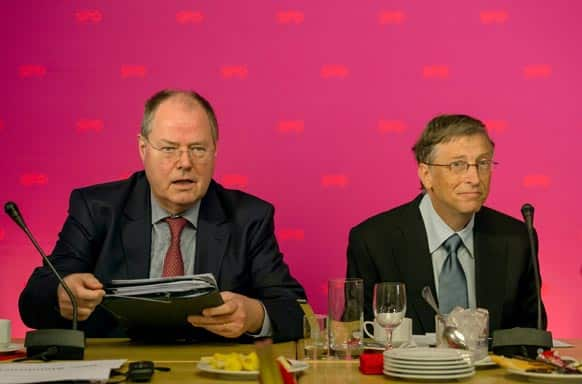 Chancellor candidate of the German Social Democrats, SPD, Peer Steinbrueck and Microsoft co-founder Bill Gates, from left, attend an SPD conference in Hermannswerder near Potsdam, Germany.