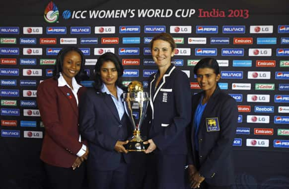 Captains of Women`s cricket teams from left, West Indies' Merissa Aguilleira, India's Mithali Raj, England captain Charlotte Edwards and Sri Lanka's Shashikala Siriwardena pose with the ICC Women`s World Cup 2013 trophy in Mumbai.