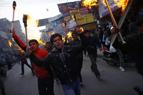 Activists of Nepali Congress party affiliated Nepal Student Union stage a torch rally through the streets against Prime Minister Baburam Bhattarai in Katmandu.