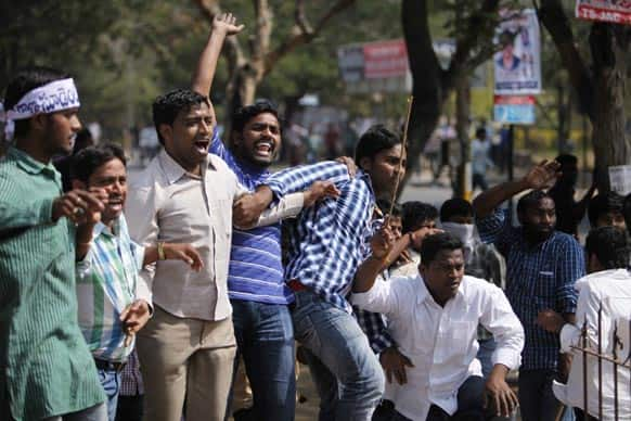 Students shout slogans during a protest demanding the creation of a separate Telangana state, in Hyderabad.