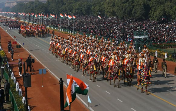 Camel mounted Indian Border Security Force soldiers in their ceremonial uniform march during Republic Day celebrations, in New Delhi.