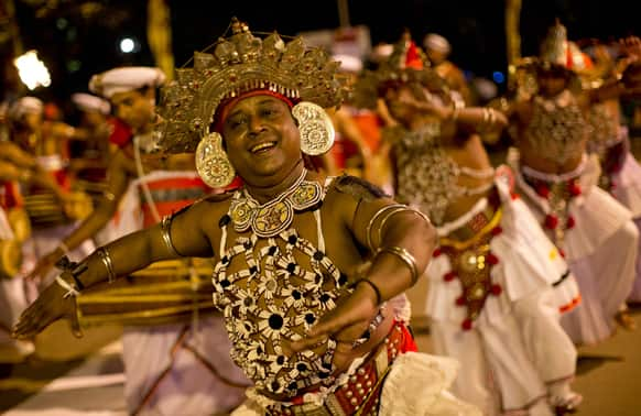 Traditional dancers perform during an annual Buddhist procession in Kelaniya, suburbs of Colombo.