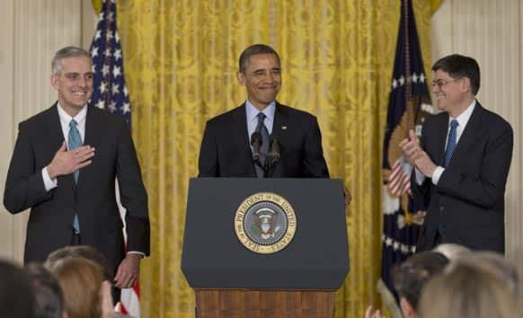 President Barack Obama, with current White House Chief of Staff Jack Lew, right, announces that he will name current Deputy National Security Adviser Denis McDonough,left, as his next chief of staff, in the East Room of the White House in Washington.