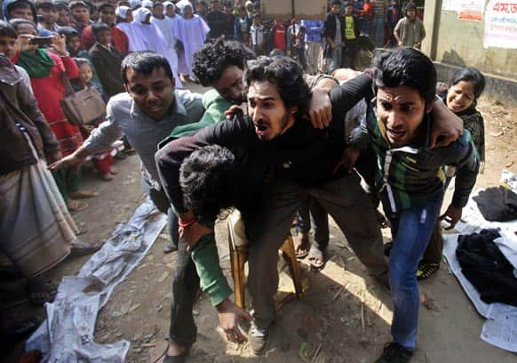 Bangladeshi activists perform a street play during a protest demanding punishment for the Tazreen Fashions factory owner and compensation for the victims outside the factory in Savar, on the outskirts of Dhaka.