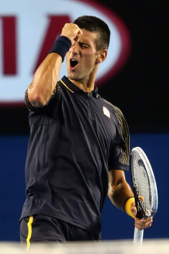 Serbia`s Novak Djokovic celebrates after winning his semifinal match against Spain`s David Ferrer at the Australian Open tennis championship in Melbourne.